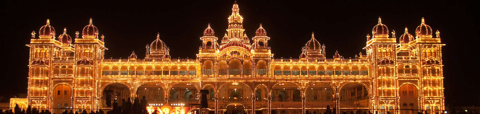 See Ambavilas Palace, Mysore Palace illuminated at night on a luxury holiday to South India