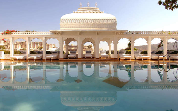In Rajasthan, stay at the iconic Taj Lake Palace Hotel in Udaipur
