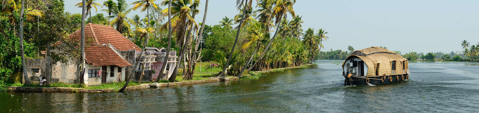 Relax on a slow backwater cruise on a tailor made holiday to Kerala